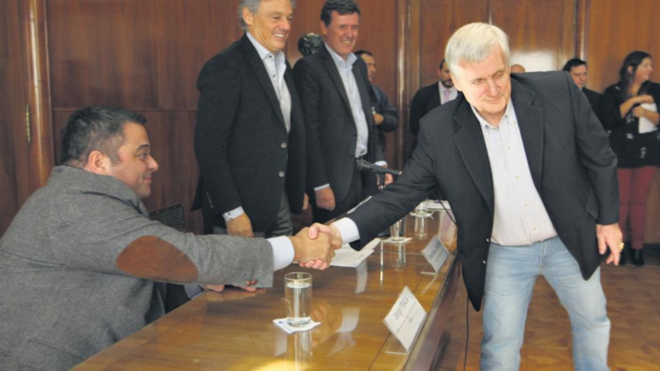 El ministro de Trabajo, Jorge Triaca, y el titular de la UOM, Antonio Caló.