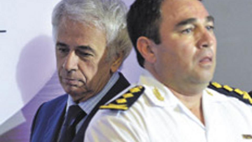 El ex gobernador De la Sota junto a su ex jefe de la policía provincial.