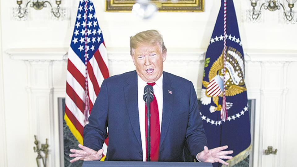 Trump presentó su plan migratorio ayer en el Salón Diplomático de la Casa Blanca.