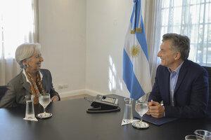 La ex la titular del FMI, Christine Lagarde, junto al ex Presidente, Mauricio Macri. (Fuente: AFP)